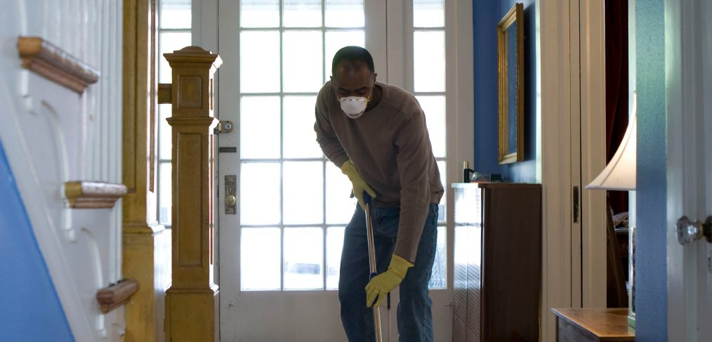 person cleaning floor